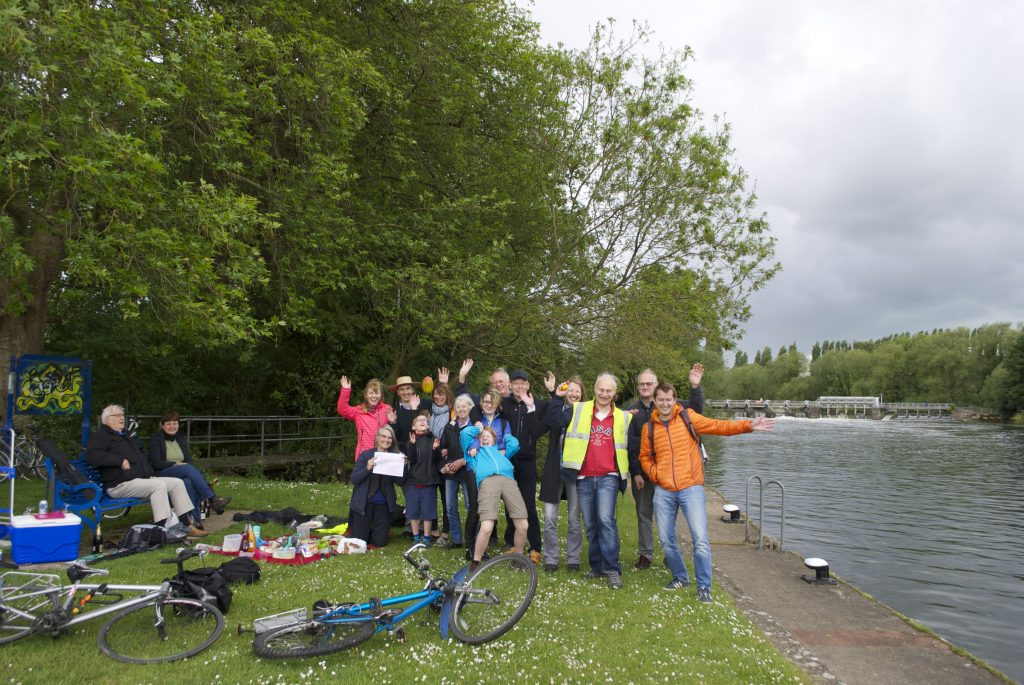 Group of Reading Hydro members celebrating by Caversham Weir